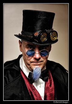 Steampunk man with a tophat, goggles, and tinted lenses