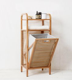 It's pretty, eco-friendly, and functional. Made from bamboo and recycled plastic bottles, this hamper comes with shelves to hold other essentials besides your dirty clothes. Ritz Bamboo Laundry Hamper, $149. westelm.com. - HouseBeautiful.com