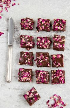 Top homemade brownies with pretty edible rose petals.