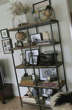 metal and wood shelf artfully arranged