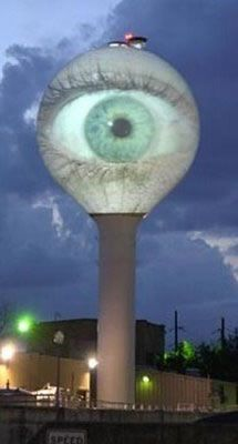 The one above is in Austin, Texas. No surprise there, they're just Keeping Austin Weird.    But it's not painted on the tower. Instead it was a real-time projection of an eyeball onto the tower done last New Year's Eve. You can see video of the event at YouTube.