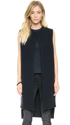 Victoria Beckham Sleeveless Coat Vest (at Shopbop) has a great length for winter. Only wish the front were less boxy and plain--I think some darting at the collar line would be interesting.