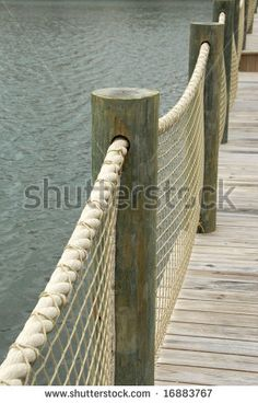 Boardwalk with Rope Railing - posts are too big but the concept without the netting would work using 2 pressure treated 4 x 4s in ground and rope strung through the holes.