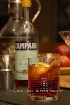 Left-Hand Cocktail, I want to try this because it uses Chocolate Bitters.  1-1/2 ounce Bourbon 3/4 ounce Carpano Antica Formula {Red Vermouth} 3/4 ounce Campari 2 dashes Chocolate Bitters Brandied Cherry Garnish