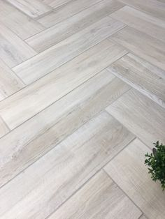 We just can't get enough of our #Aequa Series! Here's an awesome install of Aequa Nix 8x32 in a herringbone pattern. #lookslikewood https://www.arizonatile.com/en/products/porcelain-and-ceramic/aequa