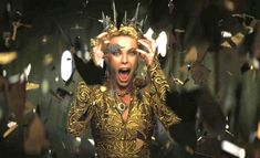 evil queen, Charlize, in the classic fairy tale, Snow White