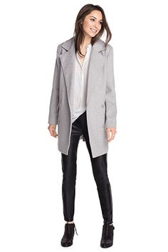 Gray coat, white button down, black skinnies....classic and always well-dressed!