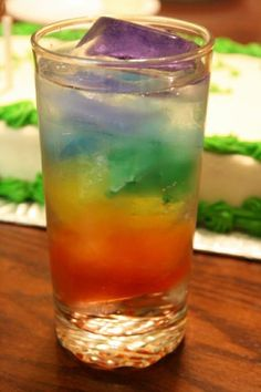 Rainbow ice water - Taste the rainbow!!! - this would be cool for Christmas drinks. Red, green and edible glitter! Cranberry & Mint?
