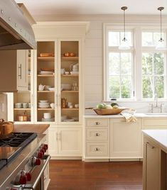 Here's another shot of this beautiful kitchen, which has an enviable collection of #copper pots hanging on walls and stashed in cabinets. The tall hutch-like cabinet is fitted with chicken-wire inserts. #elizabethbanksdesign Stylist @karinlidbeck  @mpproductions #mycountryhome #kitchen #countrykitchen #farmhousestyle #farmhousedecor