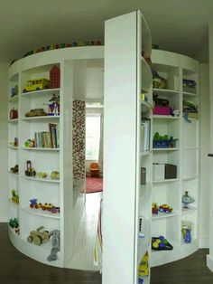 Child's reading room hidden behind toy shelves: | 31 Beautiful Hidden Rooms And Secret Passages