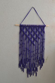 Wall panels handmade macramé technique. Material: 100% polyester. Color: purple. Strap: natural wood - pine. Dimensions: The length of the strap to the bottom, including the thread - 74cm / 29 inches Width - 38cm / 14.7 inches