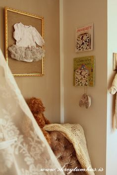 This was on a blog about the napkin holders from ikea as book holders, but I really loved the framed onsie