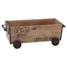 Wood cart with a distressed metal frame and typographic accents.     Product: CartConstruction Material: Wood and...