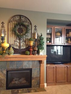 Savvy Seasons by Liz- put the iron structure above this mantle on wall next to bathroom and use wreath too.