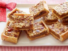 Kentucky Pecan Bars : Damaris Phillips packs all of the great flavor of pecan pie into a hand-held bar cookie. Add brightness to the sweet honey and brown sugar flavor with orange zest.