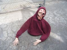 Zombie from 5 gallon bucket, wire, pvc pipe, duct tape and head, hand props
