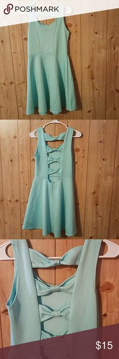 SALE ....MINT DRESS NEVER WORN Mint green dress with cutouts and cute bows on the back Dresses Midi