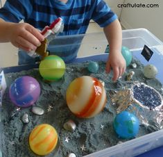 This outer space discovery bin was a really fun way to learn more about the moon, rockets, stars, planets and astronauts! Space Suits, Early Intervention, Space Theme, Astronauts, Sensory Activities, Rockets, Outer Space, Discovery, Planets