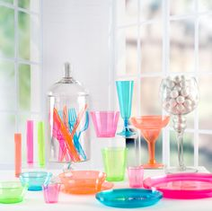 Neon Plastic Dinnerware Collection: a beautiful array of translucent colors, perfect for so many occasions.  Photo Props & Setup, Photo Direction, and package design by my company.