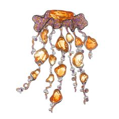 """Large """"Jellyfish"""" Fire Opal, Spessartite, Diamond and Rhodolite Pendant, Combining fire opal (57.92 carats) with spessartite garnet (4.72cttw), rhodolite garnet (5.46cttw) and diamonds (1.71cttw) and finishing the delicate edge in black enamel for a striking contrast, this piece is articulated to allow the tentacles to move. It is made of 18k white gold and can be worn on a chain or satin rope. 4.5 by 3 inches. Mouboussin. France."""