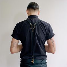 Leather O-ring suspenders.