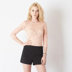 Fall in lace with this sheer lace long sleeve