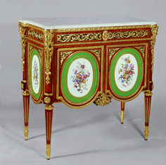 A LOUIS XVI ORMOLU AND SEVRES PORCELAIN-MOUNTED TULIPWOOD AND PARQUETRY SMALL COMMODE Circa 1776, stamped M. Carlin and twice JME 84.5 x 91 x 45cm.  $3,856,000 (2001)