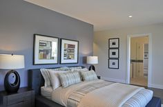 Blue bedroom with blue accent wall and taupe/beige walls