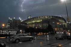 Lightning can be seen over U. S. Cellular Field in Chicago. The game between the Chicago White Sox and the Los Angeles Angels was canceled d...