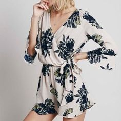 Free people romper Free people floral romper. Mid length sleeves. Flowy and very comfortable! Size- L Free People Other