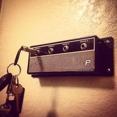 """This has to be one of the most ingenious ideas I've seen in a while...a guitar amp key holder that you can install next to your door. It comes with two """"Plug keychains"""". Ha!  Check it out here...it's surprisingly cheap and they even ship worldwide:  http://www.guitaradventures.com/guitar-amp-key-holder"""