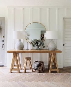 Hallway decor.   #LightingDesign #lighting #hallway #entryway #interiordesign #homedecor #consoletable #roundmirror #tablelamps #lamps #homeimprovement
