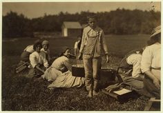 Manuel Robello, 10 years old. Picks and carries. Lives in Teaticket, Mass. Location: Falmouth - Baker Bog, Massachusetts. Sept 1910 photo by Lewis Hine