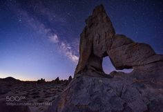 """Milky Way Over Boot Arch  """"Milky Way Over Boot Arch:"""" My trip to Alabama Hills was in early March when the Milky Way core was just beginning to make its appearance but at about 4am just before the dawn's light started blotting it out! Part of my time here was filled with clouds and snow storms so on my last morning it was a race against time as I got up very early and headed out in the dark to canvas the vast landscape for a specific arch known as """"Boot Arch"""" among other names. Thankfully I…"""