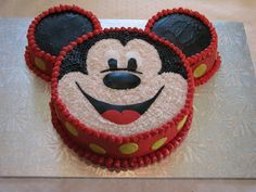 Mickey Mouse cake - Thanks to CareyI for the idea/inspiration.  Buttercream icing with fondant yellow polka dots, and facial features.  Cake is 8inch for face and then I used 2 corningware dishes that are about 3.5-3.75inch for the ears