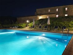 The buildings and the pool by night