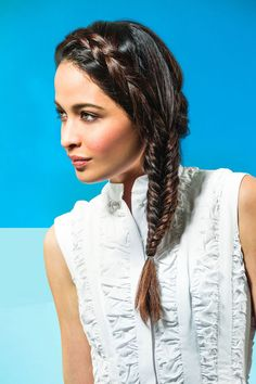 This deceivingly intricate braid works with most hair lengths. If your strands are on the shorter side, though, start the two French braids near your temples or even on the side of your head before going into the fishtail. Either way, with this look, you've got a perfect hybrid plait that'll have your old college roomie asking for a how-to. #refinery29 http://www.refinery29.com/2015/05/85988/summer-party-hairstyles#slide-9