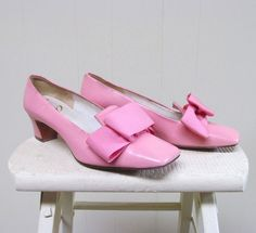 * Mod pilgrim style pumps c 1960s  * Pink leather  * Square toes * Flat over-sized grosgrain ribbon bow  * Chunky slightly tapered 2 heel * Leather sole, insole and lining    Label: Mandels    Very good condition. Very light wear. A bit of scuffing / tearing around edge of toes, as pictured    Please compare these measurements to your own shoes and convo me if your need additional measurements;    Inside Length: 9 7/8  Ball Width: 2 7/8    Mark inside is 7 M    To be certain of fit, measure…
