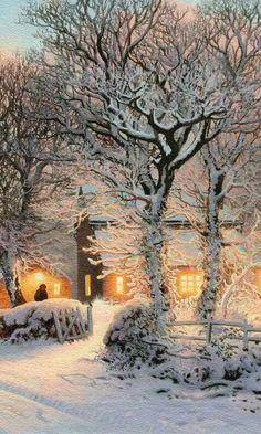 Verlichte huizen in sneeuw