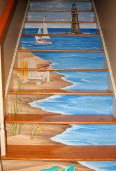 Painted staircase ideas. Featured on Completely Coastal: https://www.completely-coastal.com/2014/02/Stairs-blue-painted-staircase.html Coastal beach scene painted on stairs.