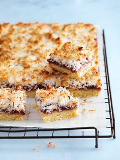 Coconut Raspberry Slice - A winning combination of nostalgic flavours, this classic homemade dessert is an instant crowd-pleaser! Tray Bake Recipes, Baking Recipes, Cookie Recipes, Dessert Recipes, Meal Recipes, Healthy Recipes, Raspberry Coconut Slice, Chocolate Coconut Slice, Raspberry Desserts