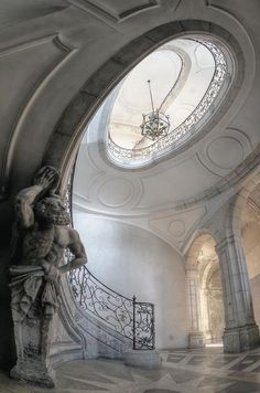 Spiral staircase in Le Louvre, Paris. The new wing of 1852–1857, by architects Louis Visconti and Hector Lefuel, represents the Second Empire's version of Neo-baroque, full of detail. The Lefuel Staircase, a monumental white stone structure boasting a double flight of stairs, richly decorated with sculptures and bathed in the light of multiple bay windows, was built between 1852 and 1858 in the north wing of the Nouveau Louvre. Now in the Richelieu Wing,