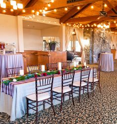Natural linen feel tablescape with our Manchester Plaid white, dark red, and tan Wide Runner atop a floor length Oat Linnea natural linen at Tannenbaum Event Center
