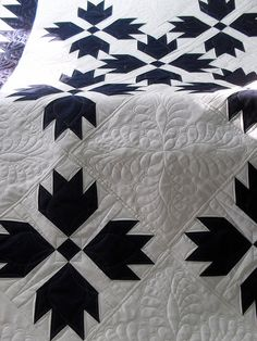 Lovely two-color bear's paw, with exquisite quilting! A simple quilt made fabulous