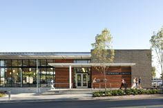 Image 4 of 19 from gallery of Kenmore Library / Weinstein A Retail Facade, Shop Facade, Modern Library, Library Design, School Architecture, Architecture Design, Modern Cafe, Brick And Wood, Building Exterior