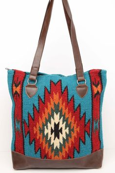 "Handwoven 100% Wool panels in classic Zapotec styles and eye catching colors with  Durable Grade 'A' soft faux leather bottom, comfortable sturdy handles. Zipper closure, fully lined with an inside pocket Approx 15"" X 16"""