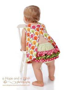 Totally buying this pattern.  I LOVE this style of apron/tunic/dress for little girls AND it suits the warning I've received about keeping them above the knee for when baby starts learning to crawl.  :)