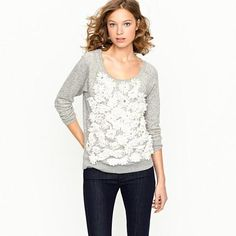 Love! J crew. A fluttering field of chiffon-petaled daisies embellishes the front of our favorite sweatshirt of the season. All done up in our lightest terry cotton yet (one touch and it feels like you've had it forever). Each silken bloom boasts a cluster of sparkly silver sequins and beads—our freshest pick yet for jeans or a polished pencil skirt. Crewneck. Three-quarter sleeves.