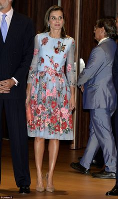 Letizia's dress featured a pink and red floral pattern and fell to just above the knee