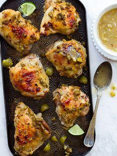 Healthy marinated roast chicken recipe with Mediterranean marinade - green olives, lime, honey, garlic, oregano, red pepper flakes.